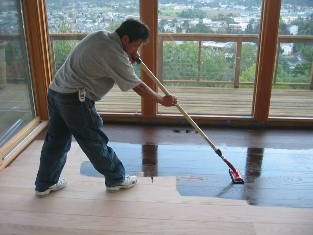 Hardwood - laying down the main coat